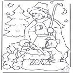 Coloriages Noël - Enfant en mangoire