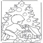 Coloriages Noël - Garçon chez l'arbre de Noël