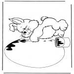 Coloriage thème - Lapin avec oeuf de Pâques