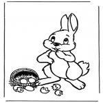 Coloriage thème - Lapin de Pâques avec des oeufs 1