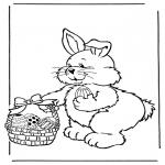 Coloriage thème - Lapin de Pâques avec des oeufs 2